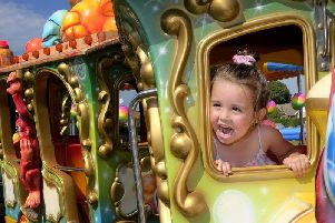 Niyah Molloy enjoys a sunshine train ride.