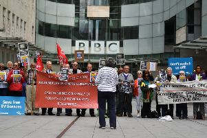 Senior citizens protest outside the BBC studios against the end of government funding for free TV licenses for the over 75s. (Getty Images)