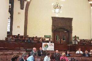 A 'Free Kashmir' flag was unfurled over the front of the public gallery.