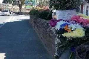 Flowers left at the scene of the accident.