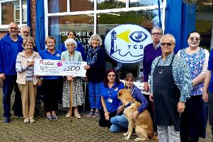 Yorkshire Coast Sight Support receives a cheque for Proudfoot.