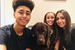 Natalie Kerr, who was given a double lung transplant seven years ago. Pictured with her children Isabelle and Brandon and the family dog, Coco.