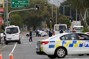 Police block the road near the shooting at a mosque in Linwood, Christchurch, New Zealand, Friday, March 15, 2019. Multiple people were killed during shootings at two mosques full of people attending Friday prayers. (AP Photo/Mark Baker).