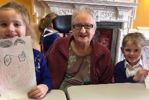 School children have been visiting residents of a care home to help brighten up their day.