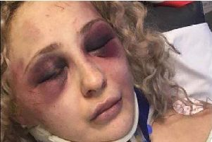 A woman was left fighting for life after an attack in her Sheffield home