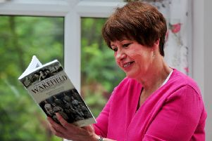Author Gaynor Haliday with her new book 'Struggle and Suffrage in Wakefield'. Picture Gerard Binks