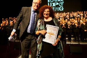 Emotional moment - Chairman of Harrogate's Business Improvement District John Fox presents a certificate to Rhiannon Gayle on behalf of the Volunteering Oscars.