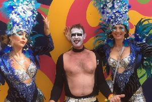 Robbie Williams, also known as Mike Scrivens makes his Beat Herder debut with a couple of dancing girls