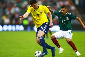 MEXICO CITY, MEXICO - JUNE 02: Jesus Manuel Corona of Mexico struggles for the ball with Scott McKenna of Scotland during the International Friendly match between Mexico v Scotland at Estadio Azteca on June 2, 2018 in Mexico City, Mexico. (Photo by Hector Vivas/Getty Images)