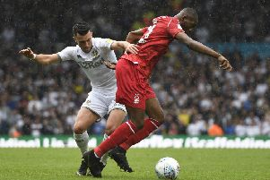 LEEDS, ENGLAND - AUGUST 10: Jack Harrison of Leeds United battles for the ball with Samba Sow of Nottingham Forest during the Sky Bet Championship match between Leeds United and Nottingham Forest at Elland Road on August 10, 2019 in Leeds, England. (Photo by George Wood/Getty Images)