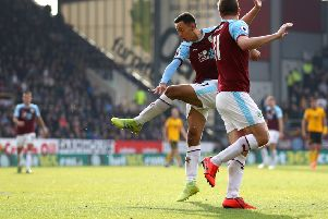 BURNLEY, ENGLAND - MARCH 30: Dwight McNeil of Burnley scores his team's second goal during the Premier League match between Burnley FC and Wolverhampton Wanderers at Turf Moor on March 30, 2019 in Burnley, United Kingdom. (Photo by Matthew Lewis/Getty Images)