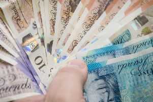 A Calderdale woman defrauded her father out of money