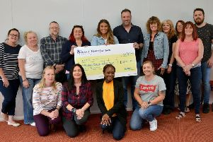 Cheque presentation to Nottinghamshire MIND from Maddie Bartrop, who raised over 1,400 by organising a race night. Maddie is pictured on the back row centre with the Notts MIND team