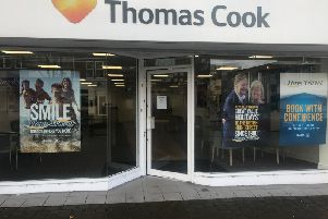 The former Thomas Cook store has not yet replaced the sign on the building.