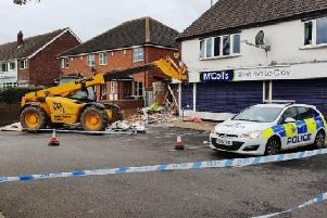 This was the scene after a JCB was used to target the ATM at the McColls store on in Holton-le-Clay, Lincolnshire.