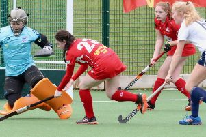 Garstang Hockey Club's Ariana Lowery trying to get round the Fylde keeper with Pip Chapman in support