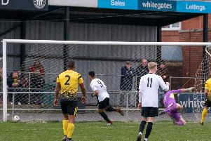 Jon Jebbison (no.9) scores for Heanor against Hucknall on Saturday. Photo by Lesley Parker.