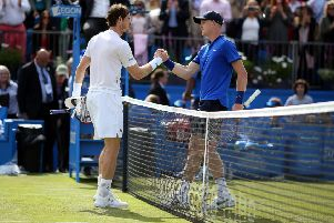Handing over: Andy Murray and Kyle Edmund.