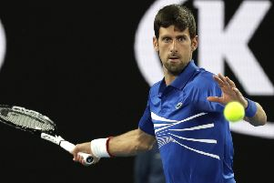 Serbia's Novak Djokovic makes a forehand return to France's Jo-Wilfried Tsonga during their second round match in Melbourne. Picture: AP/Aaron Favila.