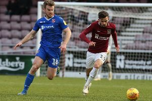 Rhys Oates (above, left) in action as Morecambe drew at Northampton Town last time out (photo: Getty Images)