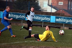 Jamie Sleigh slips the ball past keeper Rio Alberry for Heanor's opening goal.