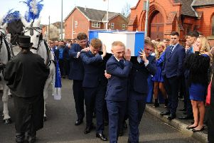 Billy's coffin is carried into church