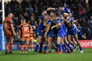 Leeds Rhinos' Brad Dwyer is mobbed by team-mates after his Golden Point drop goal saw them beat Castleford Tigers in extra-time ('Picture: Jonathan Gawthorpe).