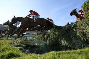 Davy Russell and Tiger Roll clear the water jump in the Grand National.