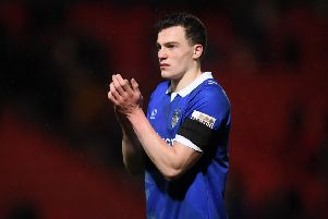 DONCASTER, ENGLAND - JANUARY 26:  George Edmundson of Oldham Athletic applauds fans after the FA Cup Fourth Round match between Doncaster Rovers and Oldham Athletic at Keepmoat Stadium on January 26, 2019 in Doncaster, United Kingdom.  (Photo by Laurence Griffiths/Getty Images)