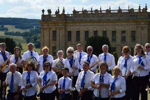 Denise Redfern, front right, with Belper Town Wind Band before a summer concert at Chatsworth House.