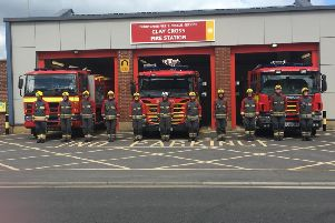 Firefights holding a minute's silence at Clay Cross.