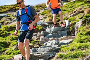 Walkers on the newly repaired Bruntscar path which winds off the peak of Whernside in the Yorkshire Dales National Park. Picture by Andy Kay/ Yorkshire Dales National Park Authority.