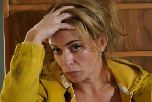 Eve Myles  and her yellow mac return in BBC1s Welsh drama Keeping Faith