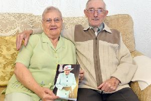Rita and William Blanksby with a card from the Queen to celebrate their 65th wedding anniversary. Picture by Brian Eyre.