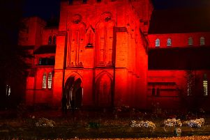Spectacular and moving tribute to Harrogate's WW1 dead -  St Wilfrids Church on Duchy Road lit up in poppy red.
