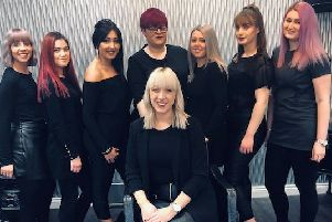 The Hairdressers and The Beauty Lodge team, including owner Belinda Hillman, seated.