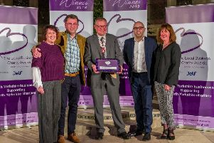 Jonathan Wild DL presents Kate Rogata and Julia Lightfoot from Harrogate Supporting Older People and Peter Richmond and Kevin Howe from Harrogate Volkswagen with the Harrogate Award at the Local Business Charity Awards for North Yorkshire.