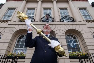 Jim Vauvert, Serjeant at Mace for Ripon City Council, holding the mayoral mace outside Ripon Town Hall.