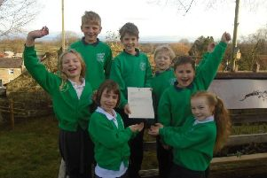Grewelthorpe C of E Primary School with the letter from local MP Julian Smith.