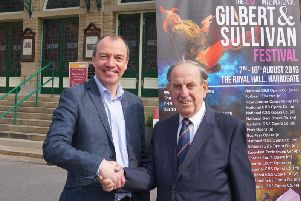 It's a deal! Coun Richard Cooper, leader of Harrogate Borough Council, and the International Gilbert and Sullivan Festival's founder Ian Smith on the steps of the Royal Hall after the signing of the contract.