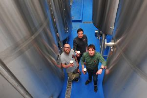 New brewery and tap room - Harrogate's award-winning Roosters. Pictured are Roosters' Tom and Oliver Fozard with tap room manager Josh Molloy, left. (Picture by Gerard Binks)