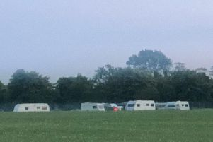 The caravan 'camp' on the Stray in Harrogate now faces legal action by Harrogate Borough Council.