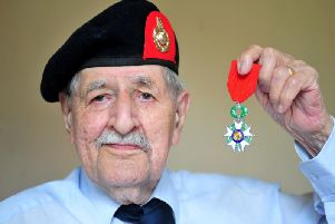 Harrogate D-Day veteran John Rushton  with his Legion D'Honneur medal  pictured at home in Harrogate last week. (Pivture by Picture Gerard Binks)