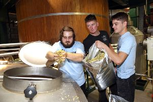 Former Black Sheep brewing apprentice Nick Norris (centre) with the firm's two latest apprentices, Jacob Slater and Matt Hunter in the brewhouse at Masham.
