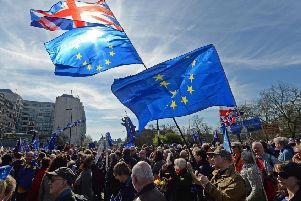 Placards and flags are held by pro-EU protesters taking part in a March for Europe rally against Brexit in central London.