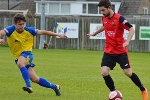 Sheffield FCs Jamie Gregory (red shirt) in action against Stocksbridge is a doubt for the visit of Pontefract due to a hamstring niggle Pic by Gillian Handisides