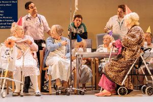 NT Live present Allelujah. Pictured are Patricia England (Mavis), Sacha Dhawan (Dr Valentine), Julia Foster (Mary) and members of the Company of Allelujah! - Photo  by Manuel Harlan.