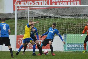 Stocksbridge Park Steels' scorer Brodie Litchfield tries to find a way past Spalding's rearguard. Credit: Gillian Handisides.