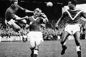 Harry Gregg (left) in action for Doncaster Rovers with Charlie Williams (right) in the 1950s.