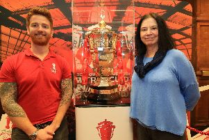 The Rugby League World Cup went on show at Sheffield Town Hall. Pictured is player James Simpson and Coun Mary Lea.